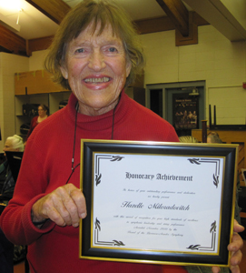 photo of Hazelle Miloradovitch with certificate