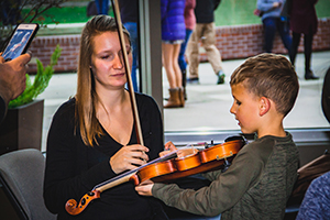 child meets violin with LAS player Amanda Bewley